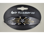 Black acrylic barrette with diamante stone detail. In oval or oblong shape