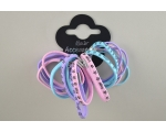 18 pastel elastics of varying thickness. 6 inscribed with 'Angel'