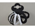 14 elastics of varying thickness in black and white.