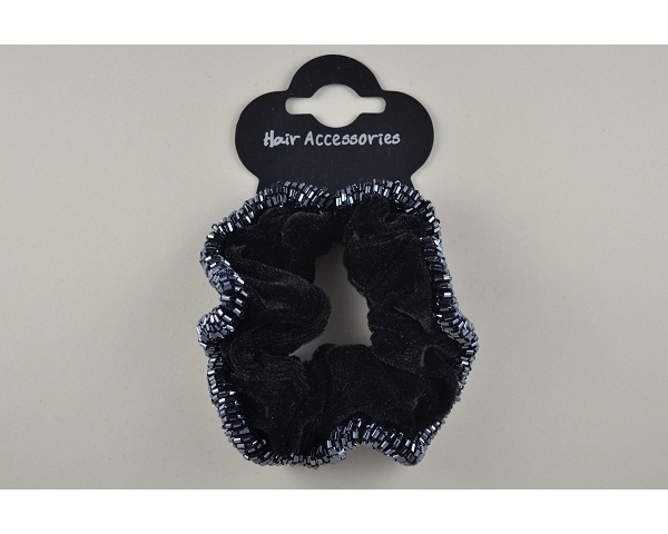 1 velvet scrunchie with beaded trim. In black