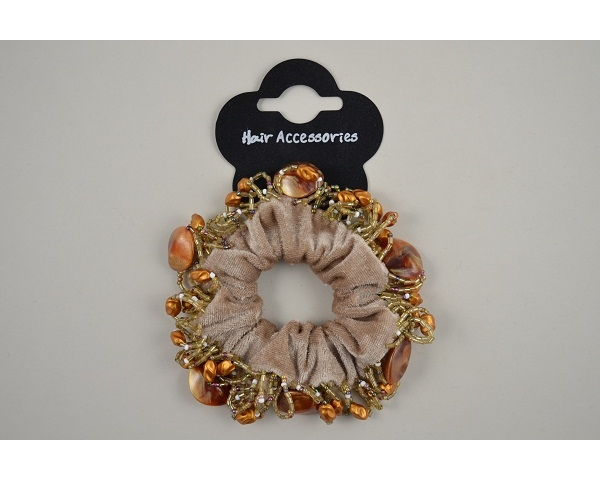 1 velvet scrunchie with beading trim. In black or beige