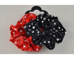 2 Christmas scrunchies with silver star print detail. 1x black & 1x red per card