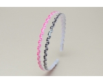 2 wavy alice bands per card with a chequered pattern. In pink & black