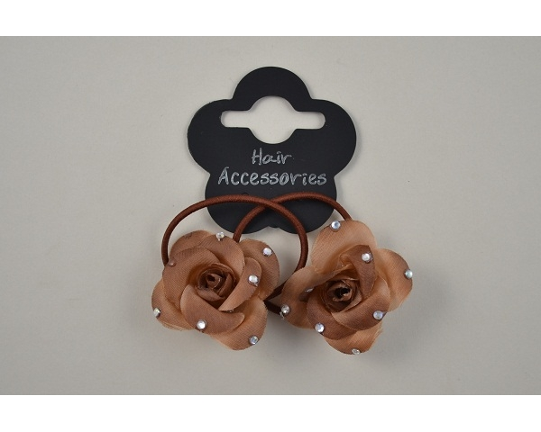 2 small roses on elastics with diamante detail per card. Packed 4x cream/beige/brown