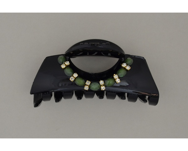 Glossy black clamp with green beads and diamante decoration. Approx 8.5cm