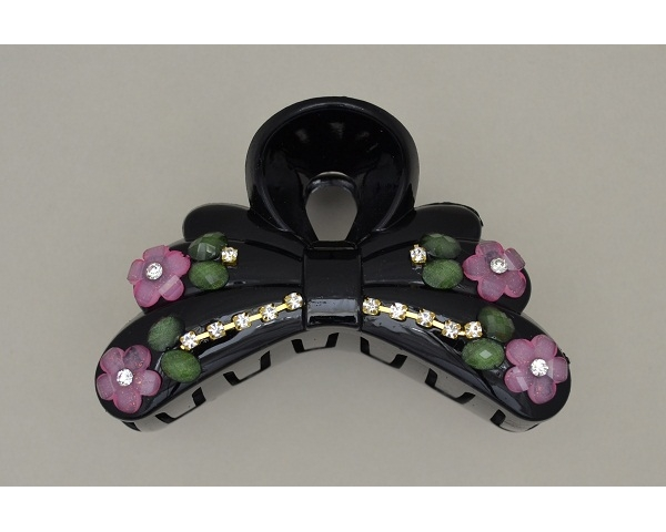 Glossy black clamp with pink flower bead, green beads & diamantes. Approx 8.5cm