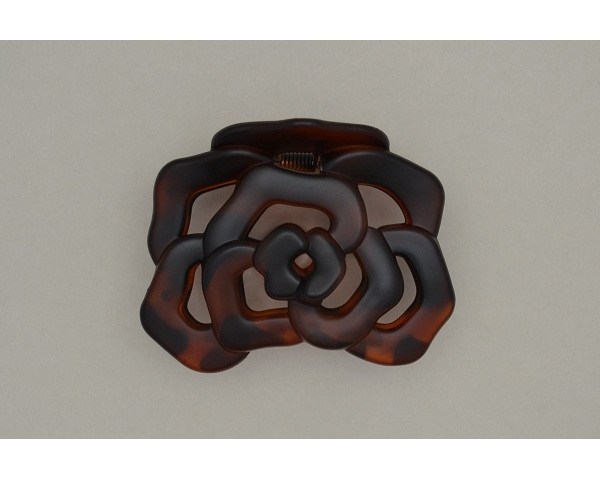 Flower shaped clamp. Packed in glossy & matt finish in torte, brown & black. Approx 7cm