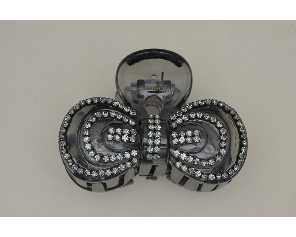 Bow shaped translucent black clamp decorated with silver beads. Approx 8cm