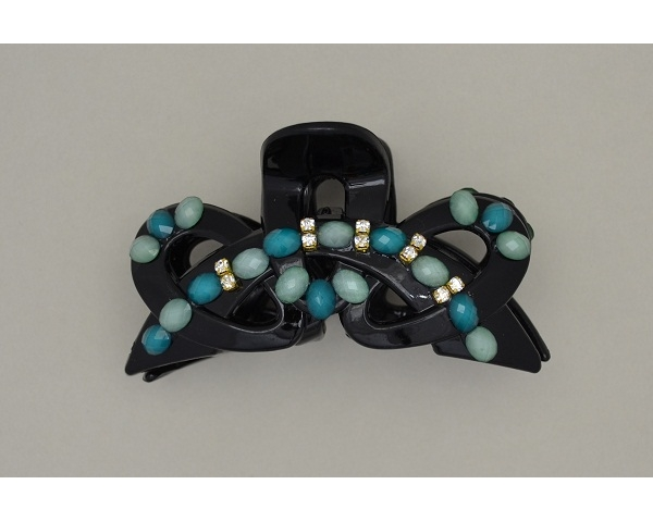 Glossy black clamp decorated with aquamarine beads & diamantes. Approx 8.5cm