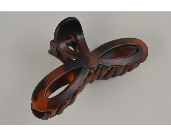 Bow shaped clamp in a matt & glossy finish. Packed assorted colours as per images.