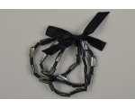 3 elasticated black pearlescent bead bracelets with sateen ribbon bow