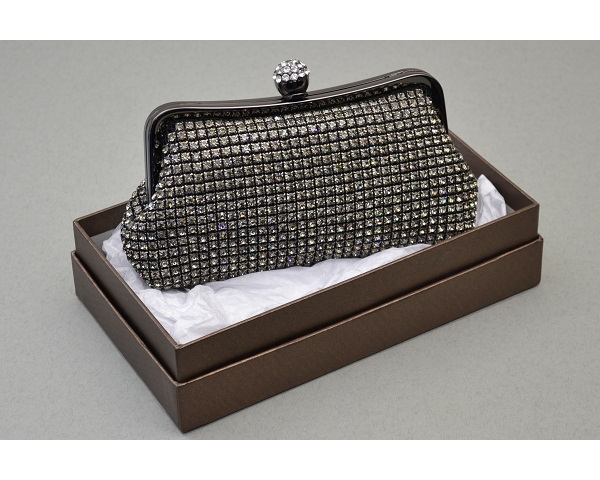 Pewter clutch bag covered in crystal stones with a round clasp encrusted with crystals. Long chain included.