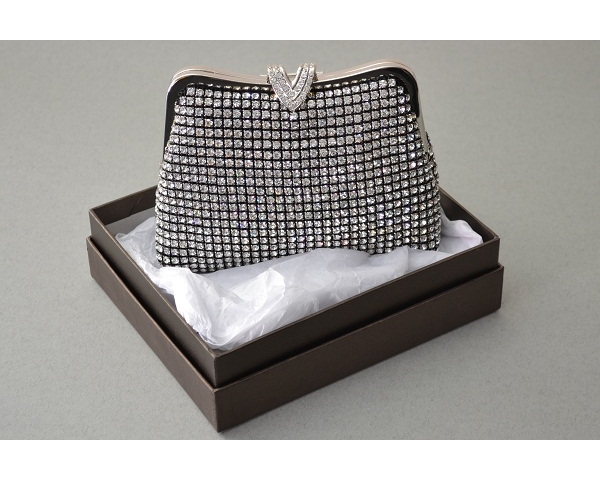 Black clutch bag covered with crystal stones with a 'V' shaped clasp with additional crystals. Long chain included