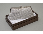 Silver clutch bag covered in crystal stones with a round clasp encrusted with crystals. Long chain included.