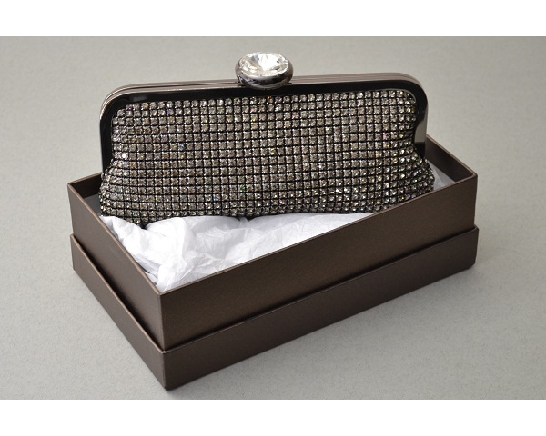 Pewter clutch bag covered in crystals with a large round diamante clasp. Long chain included