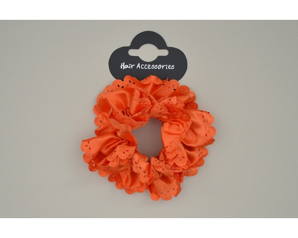 A sateen neon scrunchie with cut out detail & scalloped edge. Packed yellow, green, pink & orange