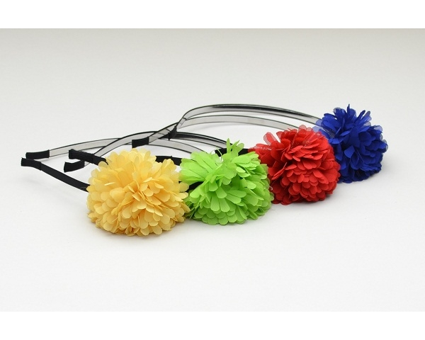 Covered metal alice band with chiffon pom pom flower in bright neon colours as shown
