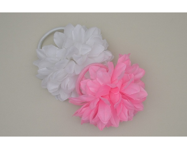 Carnation style flower on an elastic in pink & white. Uncarded. No barcode