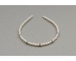 Cream pearl bead alice band decorated with diamante gems. Uncarded