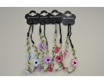 Long elastics decorated with green sateen twine and flowers. Packed assorted colours as per image