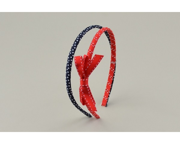 2 alice bands per card, one plain one with bow. In red and blue as per images