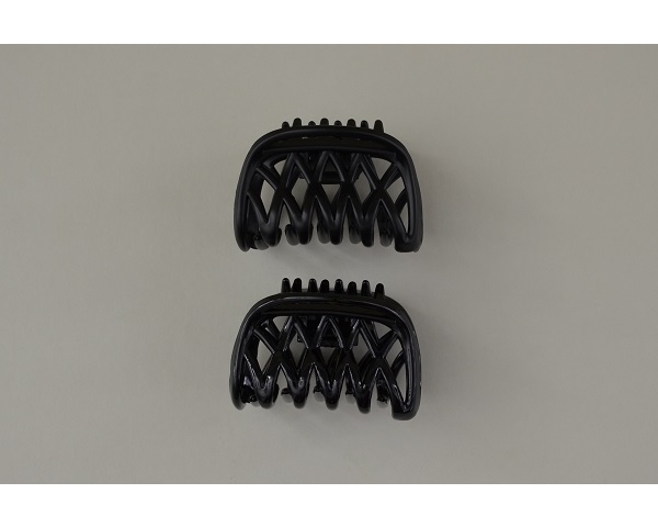 Small criss cross design clamp in black with matt and gloss finish. 7 cm approx.