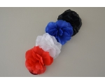 24 pretty flower on elastic. Packed in red, white, blue & black per pack. Uncarded no barcode