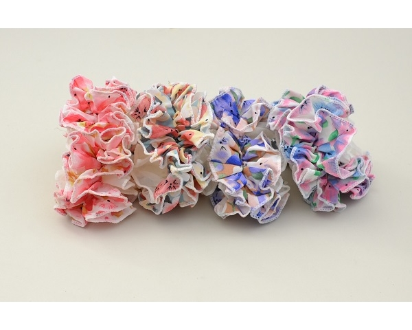 1x Large ruffle scrunchie in pretty pastel floral design. Colours as shown