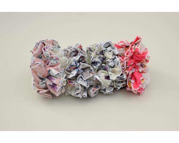 1x large ruffle scrunchie in pastel shades and floral design fabric per card. Colours as shown