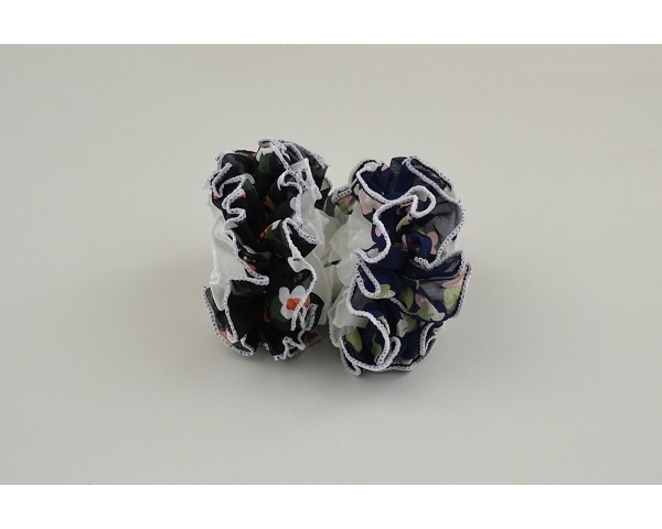 1 x Large ruffle scrunchie per card in floral design. Packed colours as per image